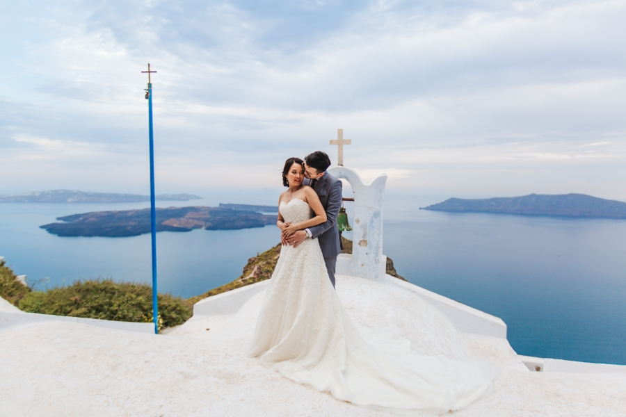 Santorini Pre-Wedding Photographer: Engagement Photoshoot In Oia During Sunset by Nabi on OneThreeOneFour 13